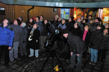 Members of the public enjoy their first views of Saturn through a telescope